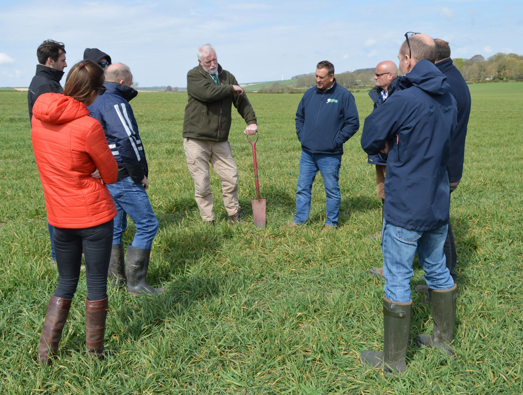 Future Foods Solutions farmers and Neil Fuller in a field for the Wolds Programme
